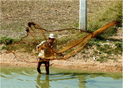 Picture Of Asian Fischer And Fishing Net