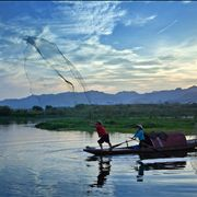Picture Of Fishermen With Net At Lake